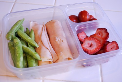 2 ounces turkey deli meat, 2 slices swiss cheese, 3 ounces sweet peas, 1/2  cup strawberry slices, and 2 ounces grape tomatoes (270 calories)